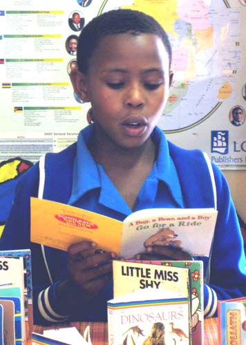 thumb_BotswanaStudentReadingALPlibraryBook