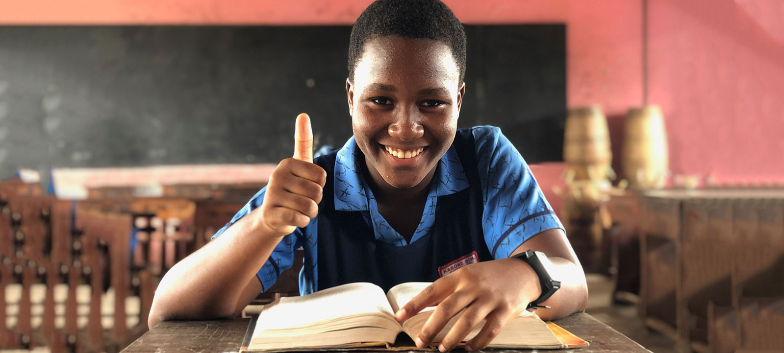 African Student giving Thumbs up