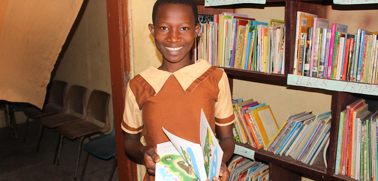 African Girl Smiling with book