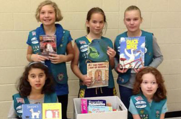 Girl Scouts Lead: Four Book Drives, Five Thousand Books, Eighteen Future Leaders!