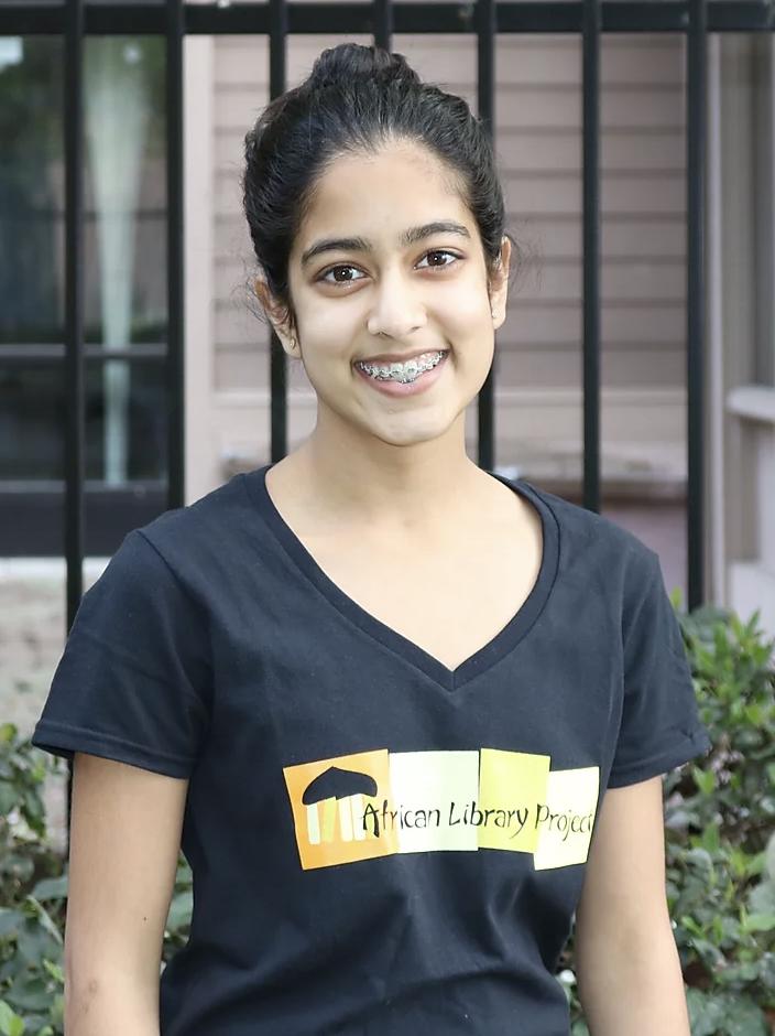 American Student wearing ALP shirt