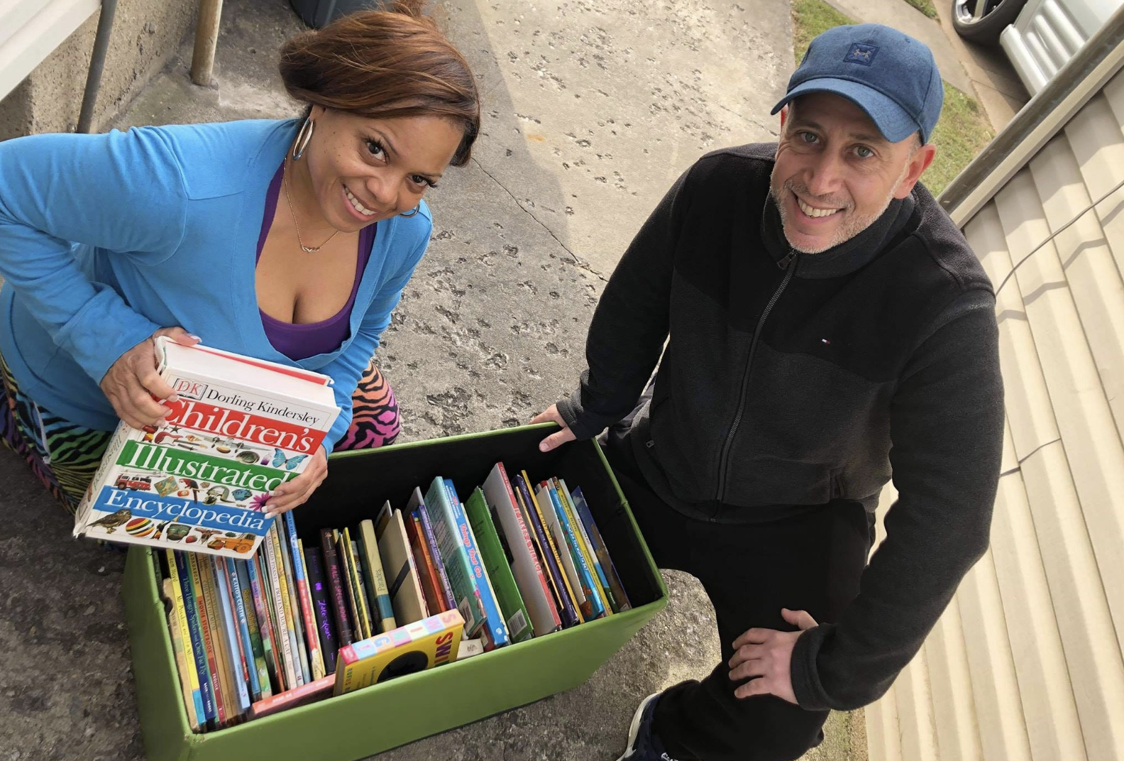American Teachers packing books in boxes