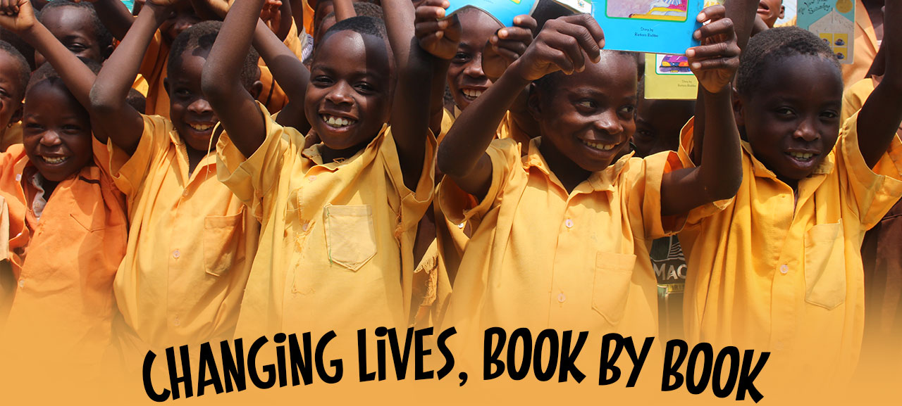 African Children Smiling holding books
