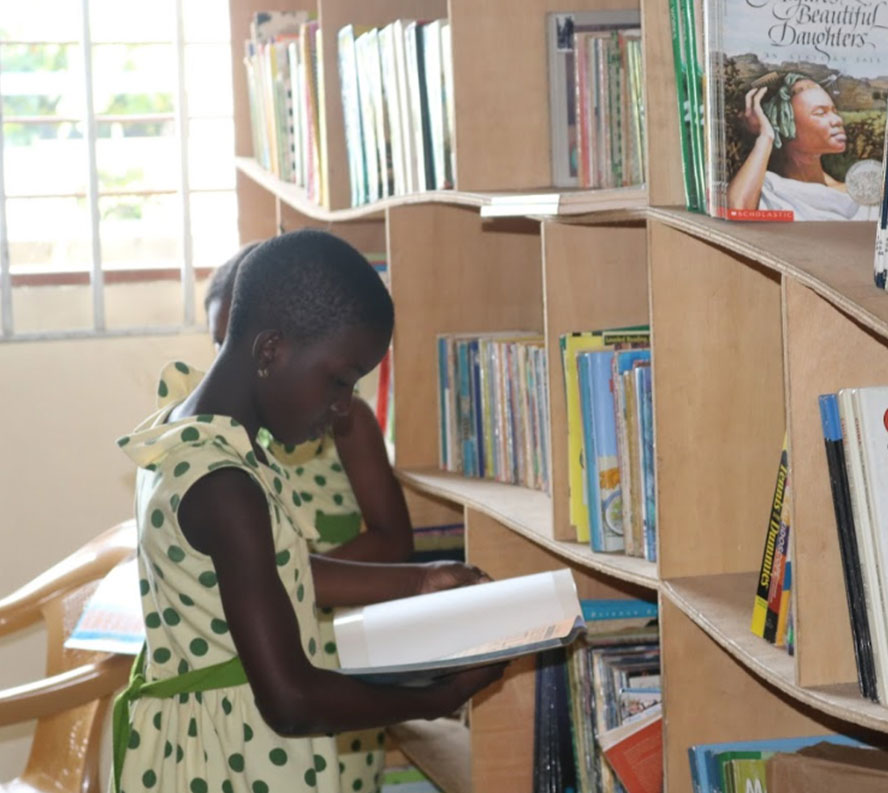 African Girl Reading Book In Library
